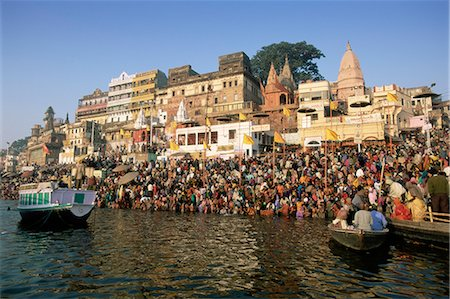 Hindu pilgrims bathing in the early morning in the holy river Ganges (Ganga) along Dasaswamedh Ghat, Varanasi (Benares), Uttar Pradesh state, India, Asia Stock Photo - Rights-Managed, Code: 841-02705787