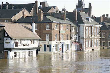 flooded homes - Flooded street in 2002, York, Yorkshire, England, United Kingdom, Europe Stock Photo - Rights-Managed, Code: 841-02706915