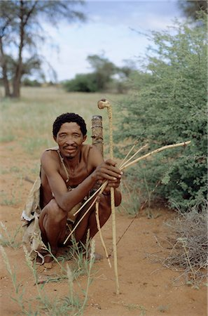 Bushman with bow and arrows, Intu Afrika game reserve, Namibia, Africa Stock Photo - Rights-Managed, Code: 841-02707618