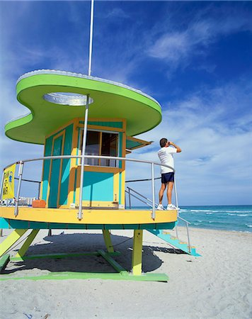 Lifeguards hut with man looking out to sea with binoculars, South Beach, Miami, Florida, United States of America, North America Stock Photo - Rights-Managed, Code: 841-02710697