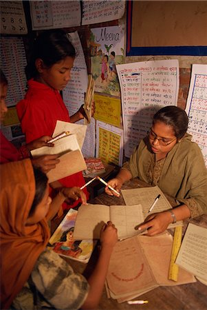 dhaka - A Bangladeshi woman teacher marks students books in a school in the slums of Dhaka (Dacca), Bangladesh, Asia Stock Photo - Rights-Managed, Code: 841-02712161