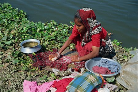 dhaka - A Bangladeshi woman washing clothes beside the river in Dhaka (Dacca), Bangladesh, Asia Stock Photo - Rights-Managed, Code: 841-02712162