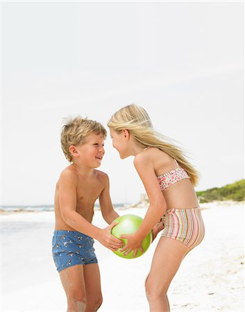 Boy and girl (6-8) on beach playing with ball Stock Photo - Rights-Managed, Code: 841-02720358