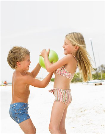 Boy and girl (6-8) on beach playing with ball Stock Photo - Rights-Managed, Code: 841-02720359