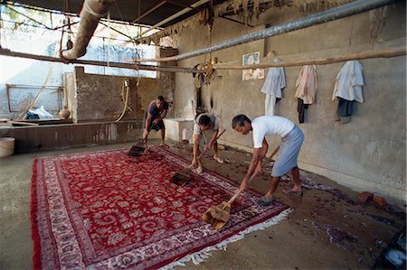 Washing newly made carpets to tighten pile and clean out dyes, Jaipur, Rajasthan state, India, Asia Stock Photo - Rights-Managed, Code: 841-02826146