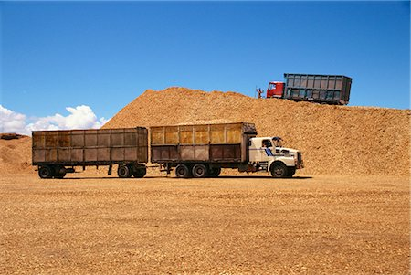 Trucks and trailers at the wood chip stocks at the port awaiting export at Puerto Montt in the Lake District of Chile, South America Stock Photo - Rights-Managed, Code: 841-02831615