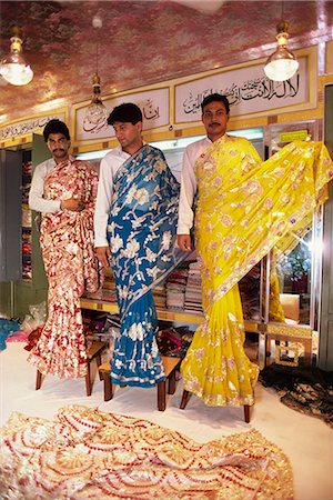Salesmen modelling saris in a textile and silk sari shop, Anarkali Bazaar, Lahore, Pakistan, Asia Stock Photo - Rights-Managed, Code: 841-02832821