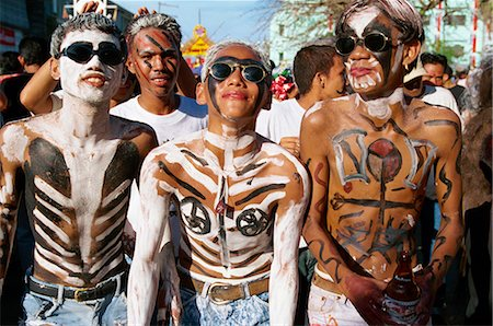 pictures philippine festivals philippines - A group of men with body decoration and sunglasses during the Mardi Gras, Ati Atihan, at Kalico on Panay Island, Philippines, Southeast Asia, Asia Stock Photo - Rights-Managed, Code: 841-02899069
