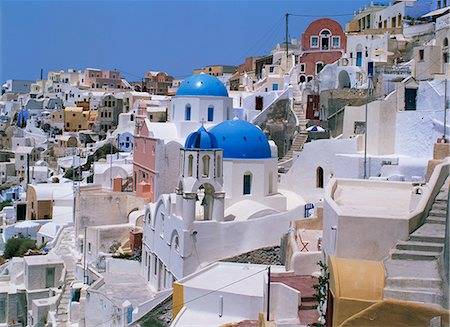 View over the blue domes and white houses of the village of Oia, Santorini (Thira), Cyclades, Greek Islands, Greece, Europe Stock Photo - Rights-Managed, Code: 841-02899441