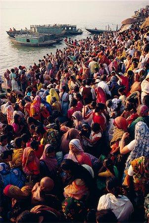 Mass bathing in the Ganges (Ganga) River during the Kartik Poonima Festival, Varanasi (Benares), Uttar Pradesh State, India, Asia Stock Photo - Rights-Managed, Code: 841-02900254