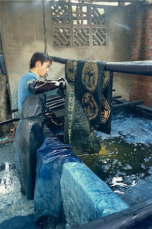 dyed - Dipping batik in an indigo vat, Guizhou, China, Asia Stock Photo - Rights-Managed, Code: 841-02901352