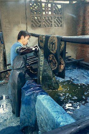 dyed - Dipping batik in an indigo vat, Guizhou, China, Asia Stock Photo - Rights-Managed, Code: 841-02901352