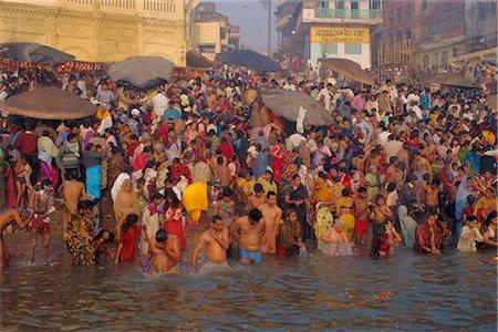 Hindu religious morning rituals in the Ganges (Ganga) River, Makar San Kranti festival, Varanasi (Benares), Uttar Pradesh State, India Stock Photo - Rights-Managed, Code: 841-02903361