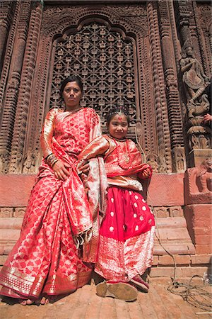 Mother and daughter stand in temple doorway at Kumari (living goddess) festival, Durbar Square, Kathmandu, Nepal, Asia Stock Photo - Rights-Managed, Code: 841-02917366