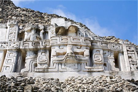 Frieze on the 130ft high El Castillo at the Mayan ruins at Xunantunich, San Ignacio, Belize, Central America Stock Photo - Rights-Managed, Code: 841-02917475