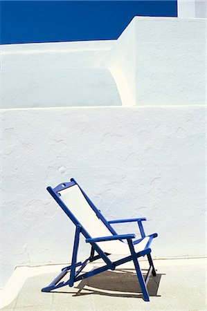 Deckchair against whitewashed wall, Imerovigli, Santorini (Thira), Cyclades Islands, Greek Islands, Greece, Europe Stock Photo - Rights-Managed, Code: 841-02917975