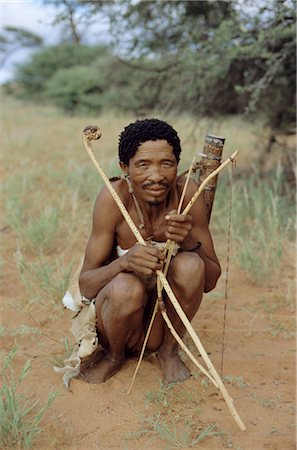 Bushman with bow and arrows, Intu Afrika game reserve, Namibia, Africa Stock Photo - Rights-Managed, Code: 841-02917989