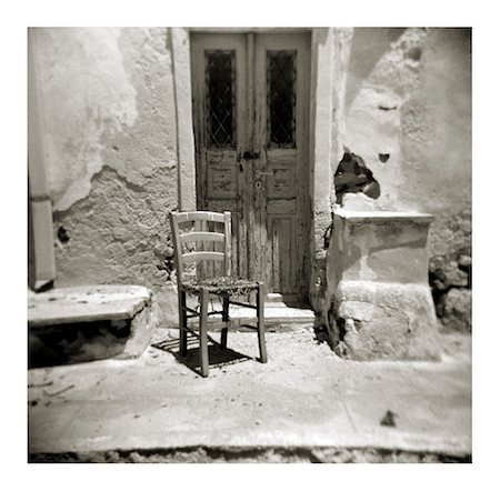 Polaroid of old chair outside building damaged by earthquake, Oia, Santorini, Cyclades, Greek Islands, Greece, Europe Stock Photo - Rights-Managed, Code: 841-02918107