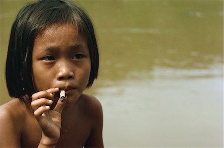 Kayan child smoking, along the Balui River, Sarawak, Malaysia, Southeast Asia, Asia Stock Photo - Rights-Managed, Code: 841-02945412