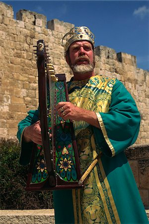 Portrait of a man with harp wearing traditional clothes singing in front of the city walls of Jerusalem, Israel, Middle East Stock Photo - Rights-Managed, Code: 841-02945726