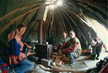 Sami man (Lapplander) inside laavo (tent), drinking moonshine, Finnmark, Norway, Scandinavia, Europe Stock Photo - Rights-Managed, Code: 841-02945950