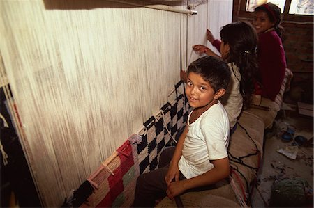 Young children weaving carpets for up to 16 hours a day in carpet factories, Jawlikhel, Kathmandu, Nepal, Asia Stock Photo - Rights-Managed, Code: 841-02946780