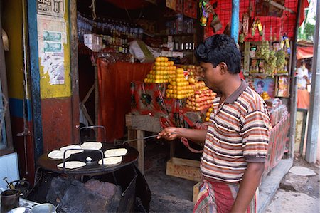 dhaka - Making parathas, Banani market, Dhaka, Bangladesh, Asia Stock Photo - Rights-Managed, Code: 841-02947096