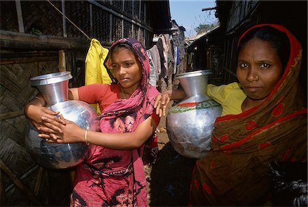 dhaka - Women with water pots in the slums, Dhaka, Bangladesh, Asia Stock Photo - Rights-Managed, Code: 841-02947134