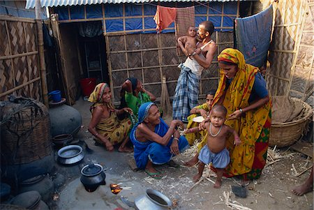 dhaka - Families in the area outside their shack in a slum in the city of Dhaka (Dacca), Bangladesh, Asia Stock Photo - Rights-Managed, Code: 841-02947135