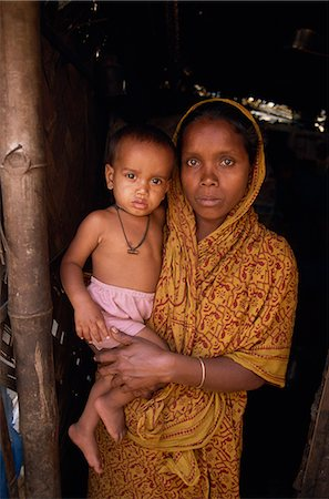 dhaka - Portrait of a Bangladeshi mother in a sari holding her young child, looking at the camera, in a slum in Dhaka, Bangladesh, Asia Stock Photo - Rights-Managed, Code: 841-02947133