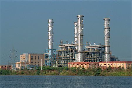 Chemical plant located on the Backwaters, Kerala state, India, Asia Stock Photo - Rights-Managed, Code: 841-02991494