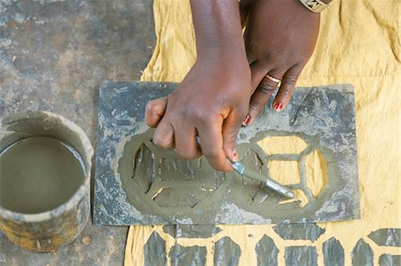 stencils - Stencilling onto cotton, Bogolan craft workshop, Segou, Mali, Africa Stock Photo - Rights-Managed, Code: 841-03033300