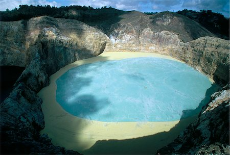 flores - One of three crater lakes at the summit of Kelimutu volcano near Moni, soil chemical creates the unusual colours, island of Flores, Indonesia, Southeast Asia, Asia Stock Photo - Rights-Managed, Code: 841-03067387