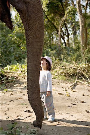 Two year old girl and the elephant that will take her on safari, at the Island Jungle Resort hotel, Royal Chitwan National Park, Terai, Nepal, Asia Stock Photo - Rights-Managed, Code: 841-03062394