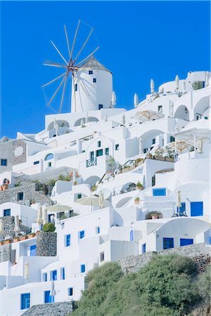 Stuccoed houses and windmill, Oia, Santorini, Cyclades Islands, Greek Islands, Greece, Europe Stock Photo - Rights-Managed, Code: 841-03489892