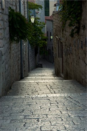 Worn stone steps between high walls in Rab Town, island of Rab, Kvarner region, Croatia, Europe Stock Photo - Rights-Managed, Code: 841-03505071