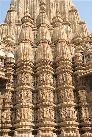 erotic female figures - Detail of the main spire with some of the 646 erotic figures carved in sandstone on the Kandariya Mahadeva Temple, largest of the Chandela temples, within Western Group, Khajuraho, UNESCO World Heritage Site, Madhya Pradesh state, India, Asia Stock Photo - Rights-Managed, Code: 841-03505169