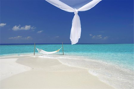 Hammock hanging in shallow clear water, The Maldives, Indian Ocean, Asia Stock Photo - Rights-Managed, Code: 841-03674997