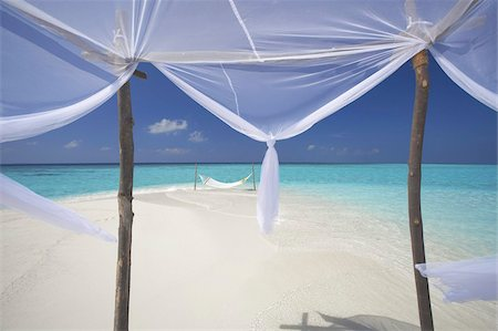 Hammock hanging in shallow clear water, The Maldives, Indian Ocean, Asia Stock Photo - Rights-Managed, Code: 841-03674998