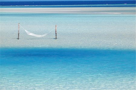 Hammock hanging in shallow clear water, Maldives, Indian Ocean, Asia Stock Photo - Rights-Managed, Code: 841-03675004