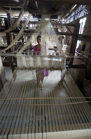 Woman at village silk loom weaving Assam Muga natural undyed silk in Sualkuchi, Assam, India, Asia Stock Photo - Rights-Managed, Code: 841-03675404