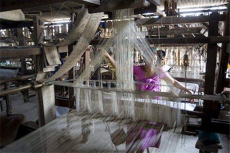 Woman at village silk loom weaving Assam Muga natural undyed silk in Sualkuchi, Assam, India, Asia Stock Photo - Rights-Managed, Code: 841-03675403