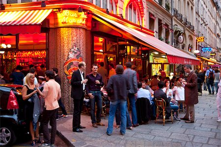 People relaxing at a cafe in the evening, Left Bank, Paris, France, Europe Stock Photo - Rights-Managed, Code: 841-03676932