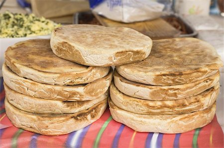food stalls - Traditional Madeiran flat bread is cooked and served at a stall in Funchal, Madeira, Portugal, Europe Stock Photo - Rights-Managed, Code: 841-03677207