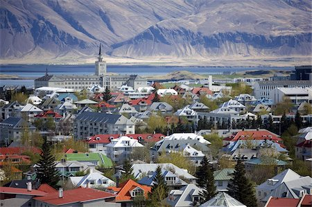 View over Reykjavik with mountains looming in the distance, Reykjavik, Iceland, Polar Regions Stock Photo - Rights-Managed, Code: 841-03672469
