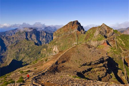 Hiker in red jacket walking down new footpath across the volcanic landscape towards Madeira's third highest peak, Pico do Arieiro, Madeira, Portugal, Europe Stock Photo - Rights-Managed, Code: 841-03672695