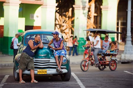 placing - Men relaxing on a 1950s classic American car, Central Havana, Cuba, West Indies, Caribbean, Central America Stock Photo - Rights-Managed, Code: 841-03672982