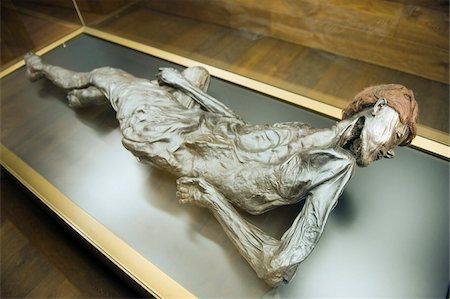 prehistoric - Preserved body of the 2000 year old Grauballe Man, Moesgard Museum of Prehistory, Arhus, Jutland, Denmark, Scandinavia, Europe Stock Photo - Rights-Managed, Code: 841-03673020