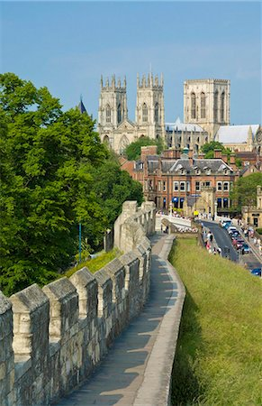 York Minster, northern Europe's largest Gothic cathedral, and a section of the historic city walls along Station Road, York, Yorkshire, England, United Kingdom, Europe Stock Photo - Rights-Managed, Code: 841-03868215