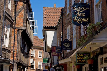 The Shambles, the narrow street of half-timbered old medieval buildings where butchers used to sell sides of meat from hooks and rails that are still visible above the windows, York, Yorkshire, England, United Kingdom, Europe Stock Photo - Rights-Managed, Code: 841-03868218
